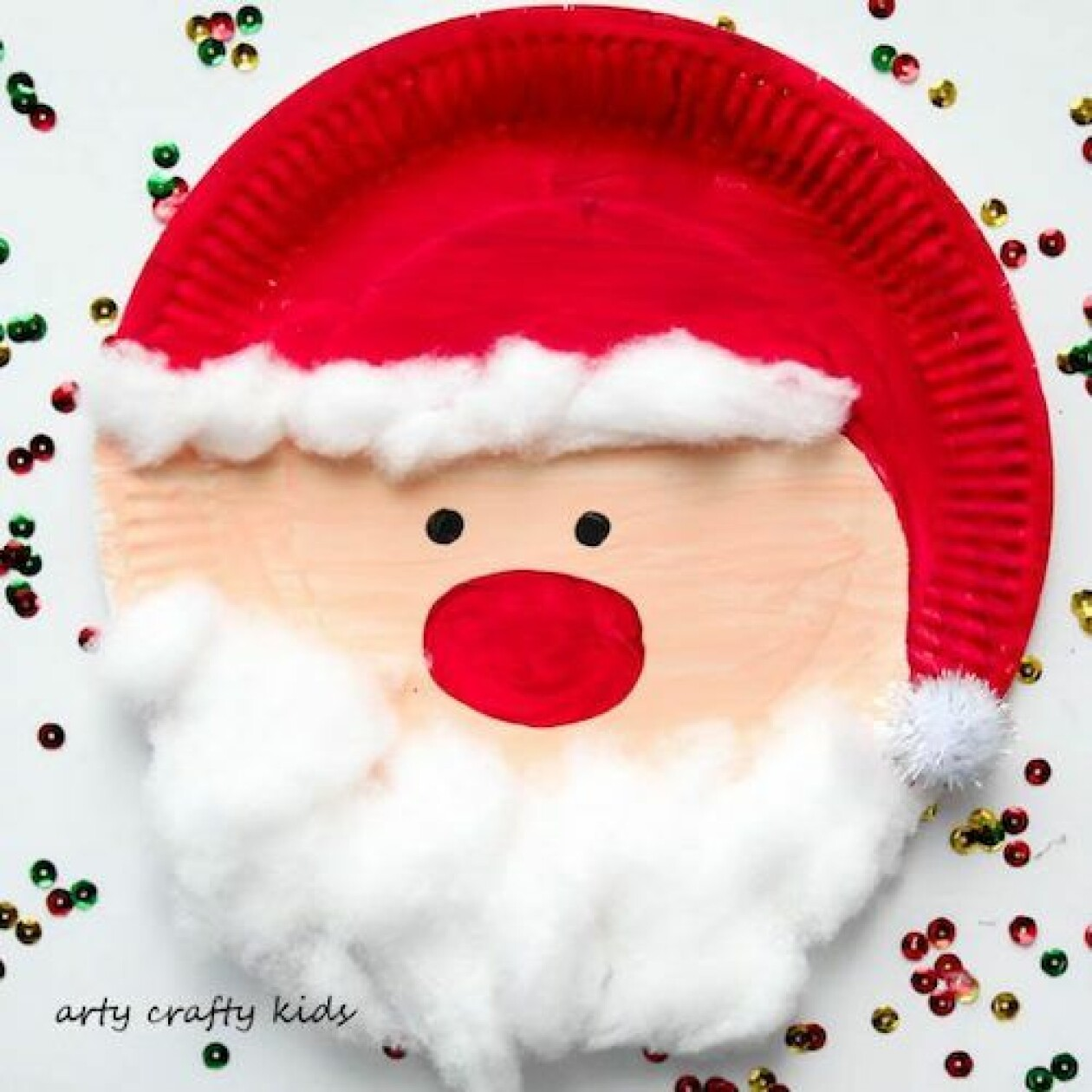 Julpyssel med barn papptallrik tomte