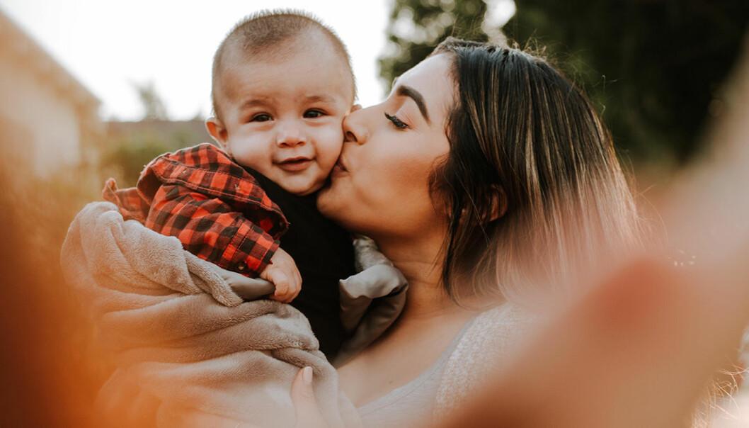 Kvinna med litet barn.